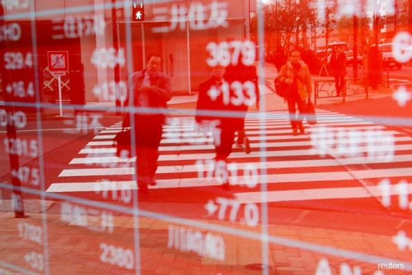 Asia shares rise on U.S.-China trade deal optimism, Aussie tumbles