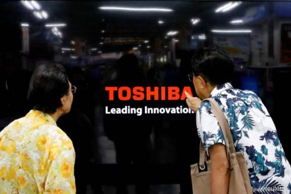Toshiba says to appoint ex-banker as next CEO
