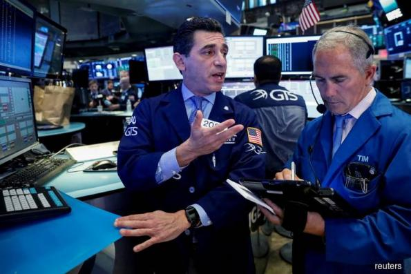 Wall St ticks higher to record close; eyes on earnings, Fed