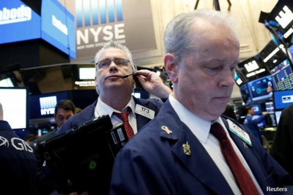 Wall St ends down; geopolitical risks weigh ahead of earnings