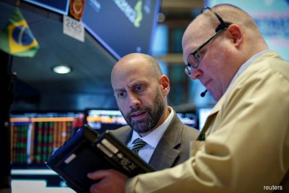 Wall St extends record run on tax overhaul optimism, solid data