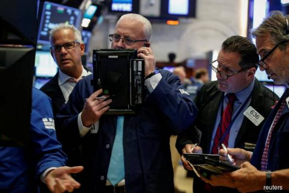 Wall St recedes from highs as quarterly reports loom