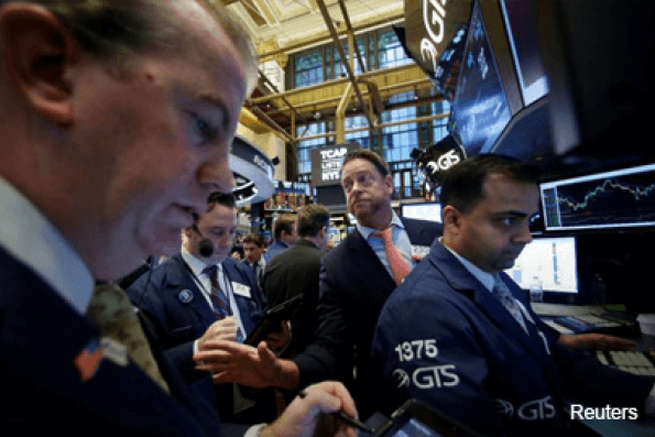 Dow hits 20,000 on revived Trump rally, earnings