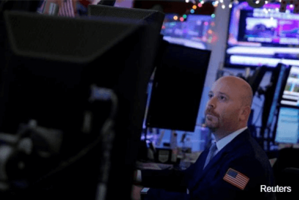 Wall St slips after soft GDP data, earnings