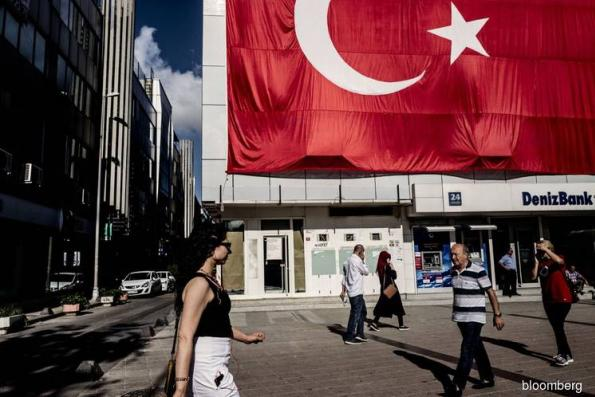 Erdogan Surrenders to Market as Rate Rise Halts Lira's Collapse