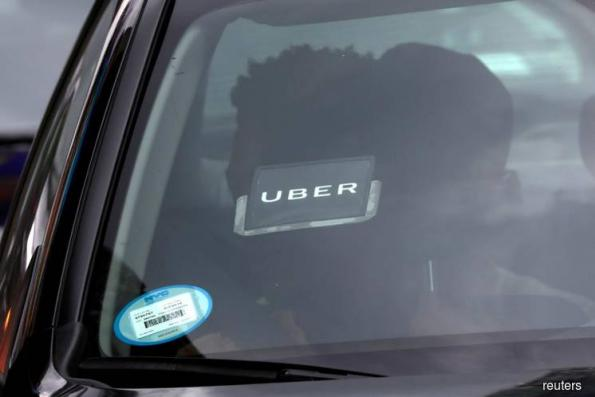 Uber narrows loss but long way from finding profit