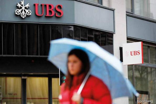 France fines UBS record €3.7b in tax fraud case
