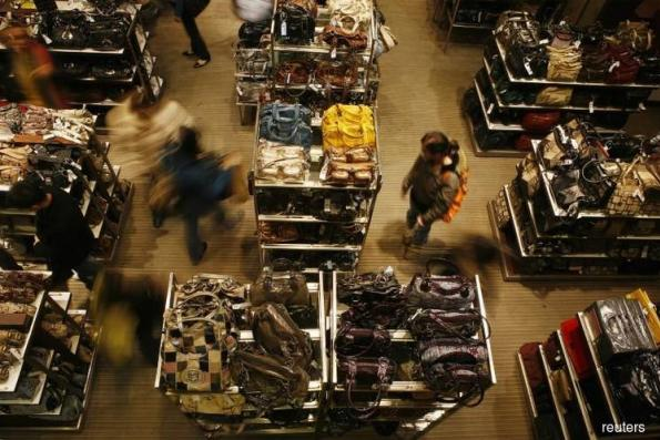 US consumer spending rises; savings drop to 10-year low