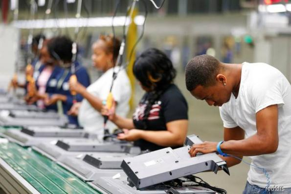 US factory activity races to 14-year high in August