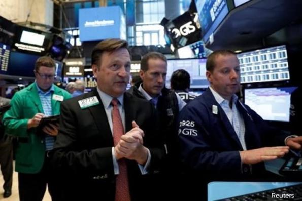 Stocks advance as dollar weakness lifts oil