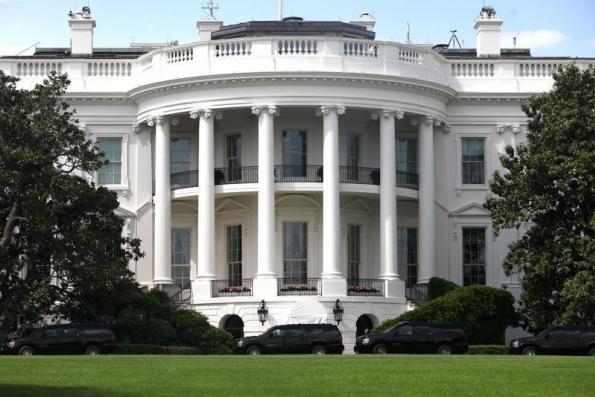 US reimposes tough curbs on Iran, Tehran hits out at 'bullying'