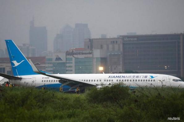 Xiamen Air passenger jet overshoots runway in Manila, no casualties