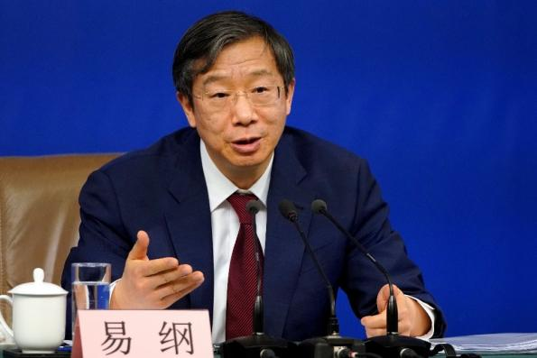 China preparing for all risks in currency policy, PBOC's Yi Says