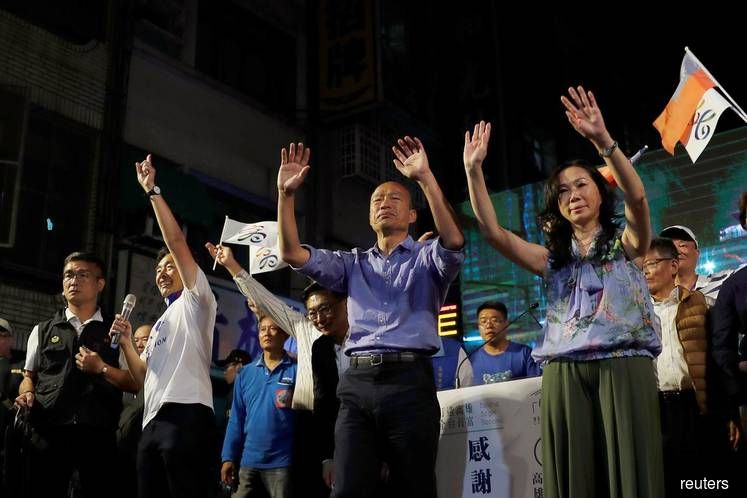 Taiwan presidential challenger's wife skips Singapore after being told no campaigning