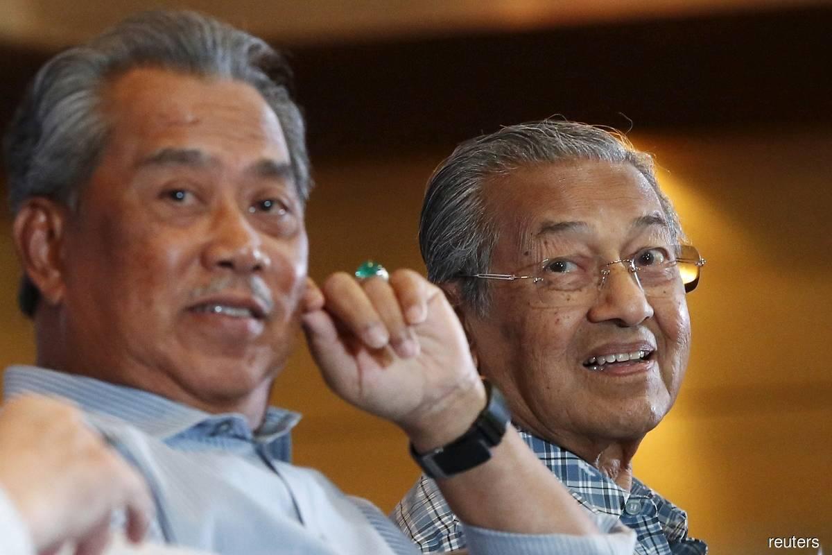Tan Sri Muhyiddin Yassin (left) and Tun Dr Mahathir Mohamad