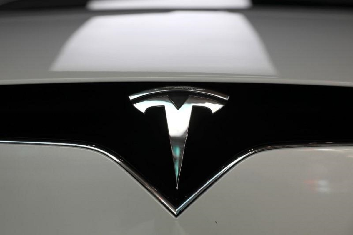 Tesla edges past Wall Street target as bitcoin sales, environmental credits boost revenue