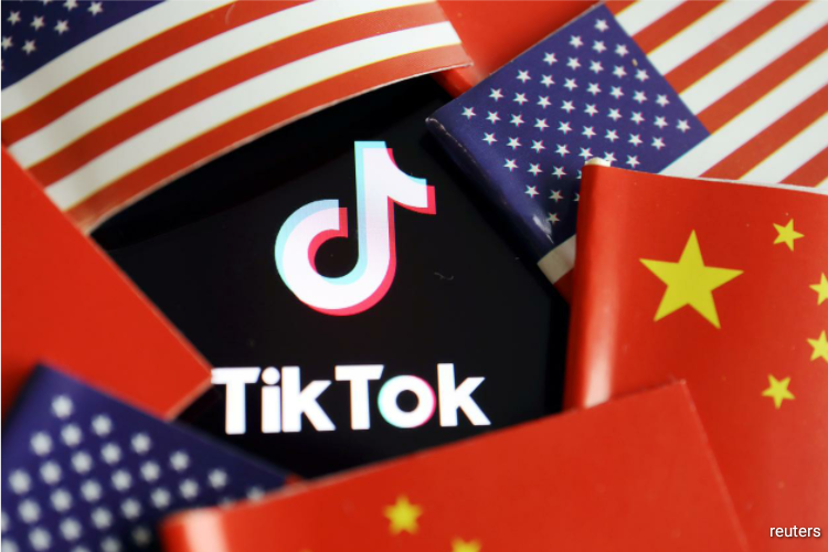 """The executive orders come as the Trump administration said this week it was stepping up efforts to purge """"untrusted"""" Chinese apps from U.S. digital networks and called the Chinese-owned short-video app TikTok and messenger app WeChat """"significant threats."""""""