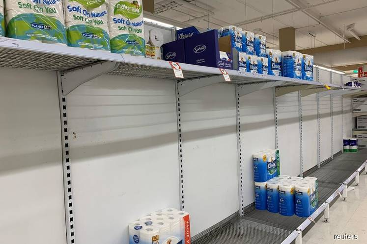Empty shelves are pictured at Coles Supermarket following reports of coronavirus in the Canberra suburb of Manuka, Australia, on March 2, 2020 in this picture obtained by Reuters from social media. (Photo by Adam Spence via Reuters)