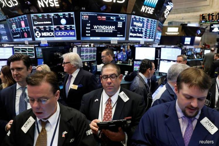 Wall St slips from near-record highs in Christmas Eve trade