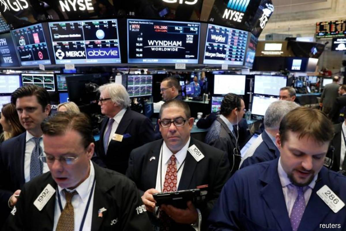 Wall St closes higher after Fed vows more support for the virus-battered economy