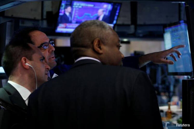 Wall St down after weak jobs, Fed comments, Syria airstrikes