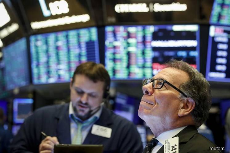 Stocks, gold surge as Congress nears $2 trillion aid package