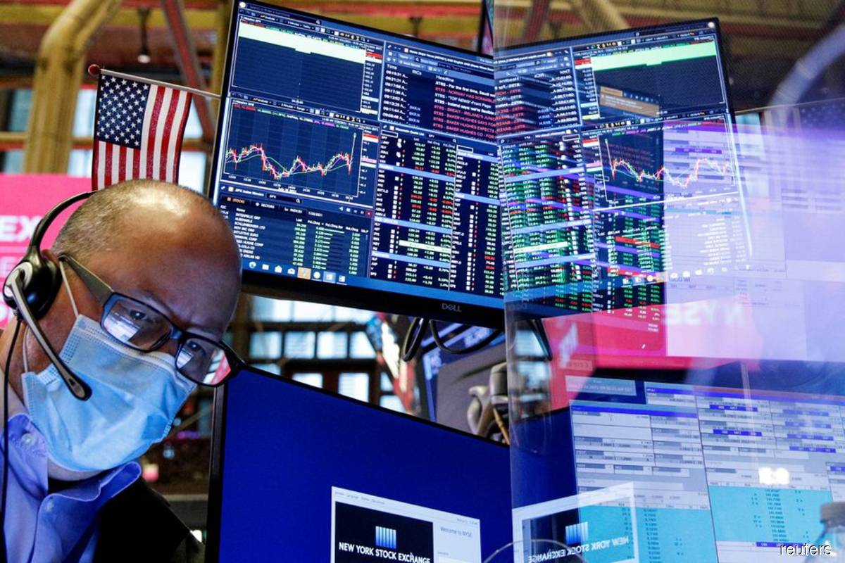 S&P 500, Dow hit record highs as defensive shares shine
