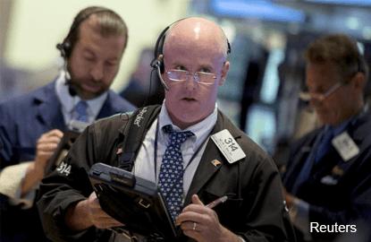 Wall St lower as investors assess G20 shift; oil falls