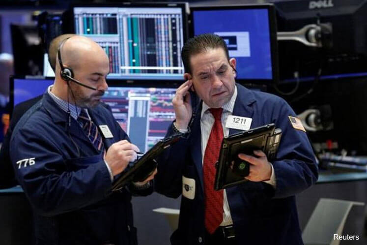 Wall St slips with healthcare stocks, Nasdaq flat