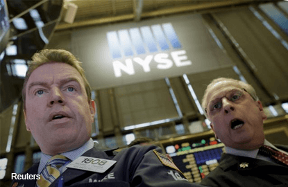 Badly bruised Wall Street finds solace in oil rebound
