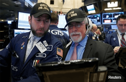 Wall St ends flat after 2-day run; Dow stays above 20,000