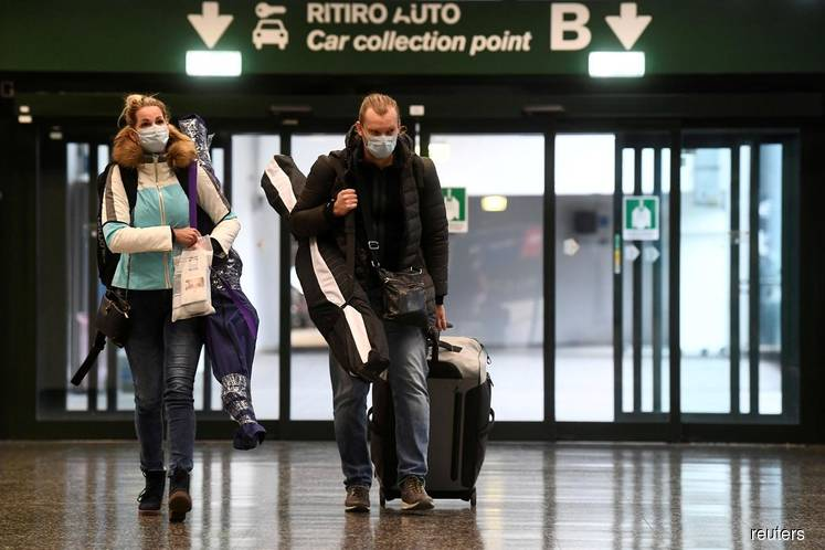 'It caused a mass panic': travellers in Europe rush to get back to US after Trump order