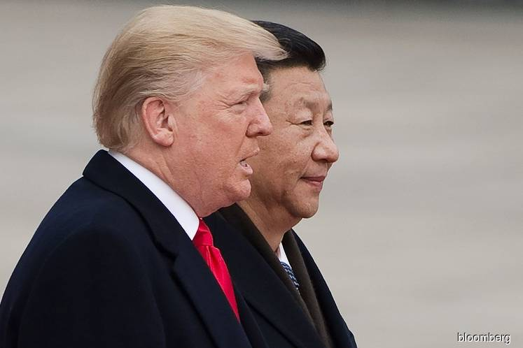 Trump says China woes help USA  in trade talks, downplays Apple warning