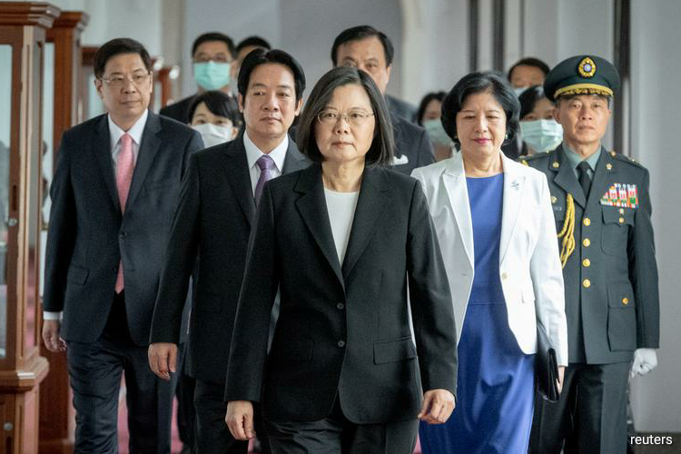In a speech after being sworn in for her second and final term in office, Tsai said relations between Taiwan and China had reached an historical turning point. (Photo by Reuters)