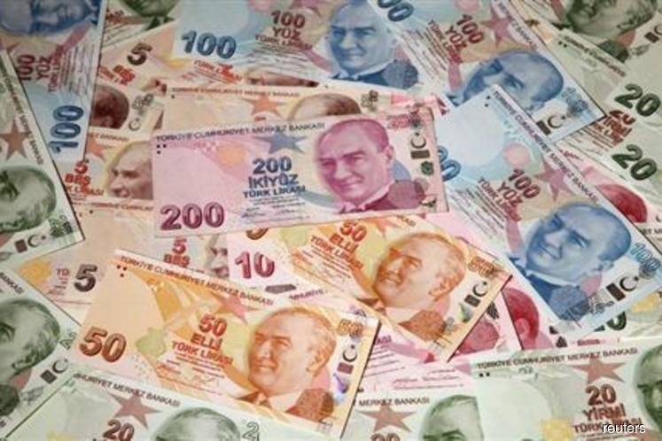 Turkish lira tumbles 5%, central bank acts on swap limits
