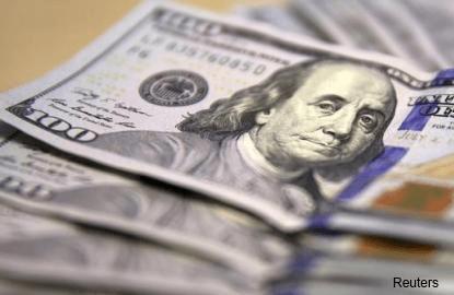 US dollar edges lower as investors await Yellen testimony