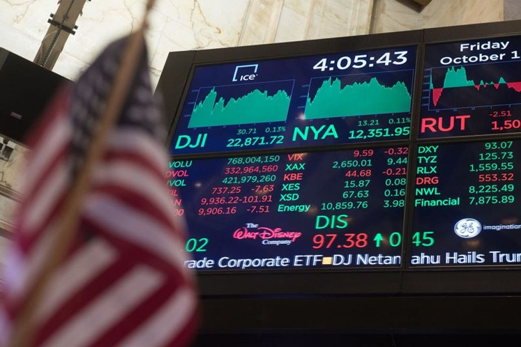 Wall St slightly higher on Microsoft results, rate cut hopes