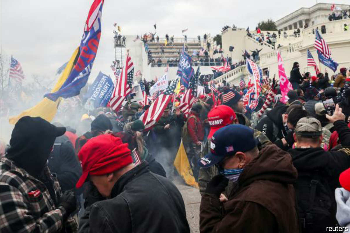 In the gravest assault on the symbol of American democracy in more than 200 years, rioters forced their way past metal security barricades, broke windows and scaled walls to fight their way into the Capitol, where they roamed the hallways and scuffled with police officers. (Photo by Reuters)