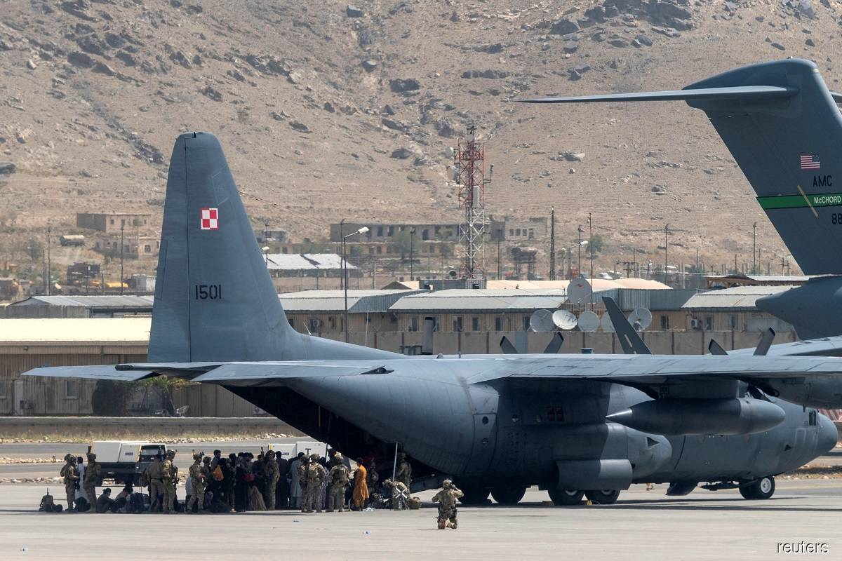 US Department of Defense service members defending military aircraft at the Hamid Karzai International Airport in Kabul, Afghanistan on Aug 17, 2021.