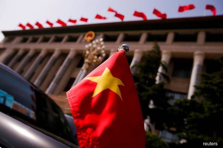 Vietnam is pushing back harder against China's efforts to isolate it diplomatically on a territorial dispute in an energy-rich part of the South China Sea.  The foreign ministry in Hanoi on Thursday called on China to immediately order a state-owned survey vessel along with several Coast Guard escorts to leave Vietnamese-claimed waters in its exclusive economic zone, which stretches 200 nautical miles from its coast. It also said a multi-billion dollar oil and gas project being carried out by state-owned Vi