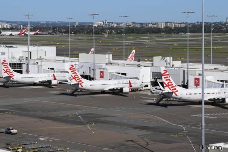 Virgin Australia collapses after pandemic halts air travel