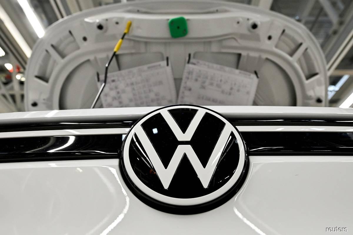 Turning coronavirus corner, Volkswagen's profit falls less than feared