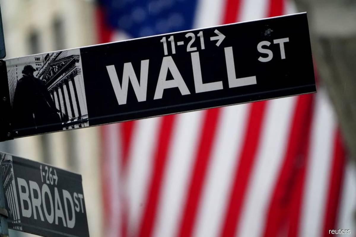 Nasdaq, S&P 500 end lower as U.S. yields rise; Disney lifts Dow