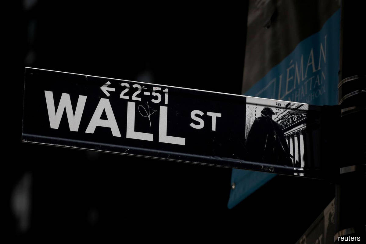 Wall Street closes at record but Facebook weighs
