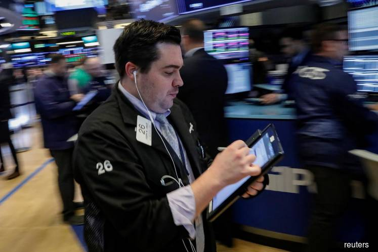 Wall St crawls to record levels on trade hopes