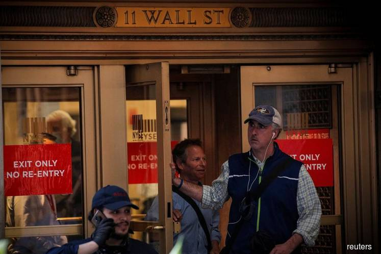 Wall Street tumbles at open on fear over fresh coronavirus cases