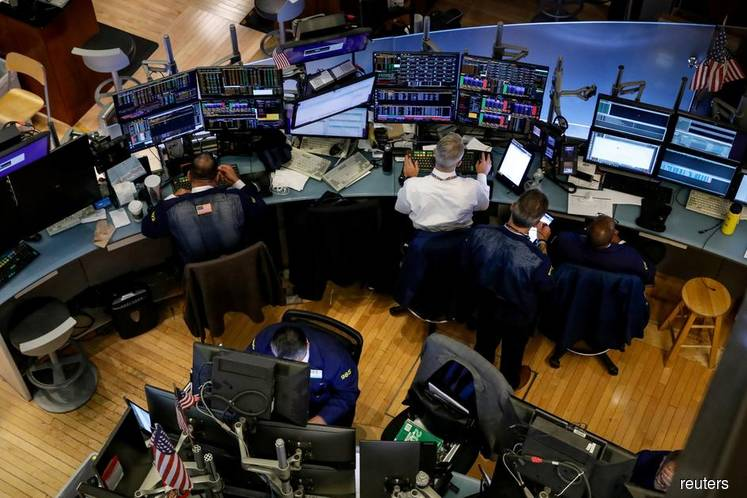 Wall Street ends flat amid rate hopes, tech declines