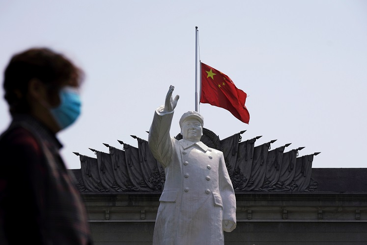 China reports no new Covid-19 cases for first time since pandemic began