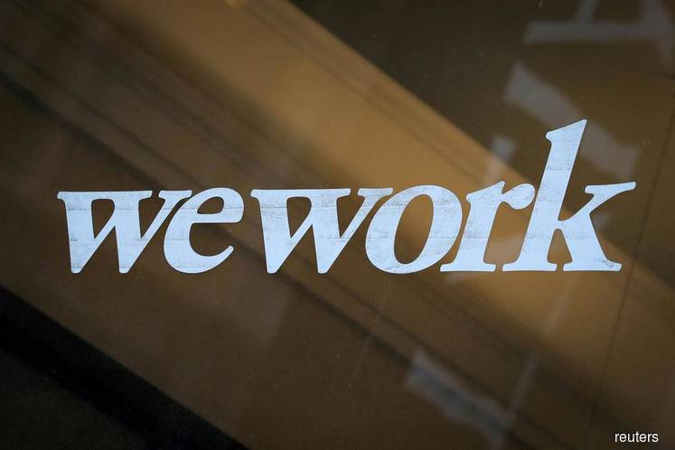 WeWork parent says IPO still on despite setbacks