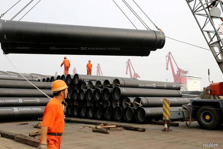 China's factory activity shrinks as US tariffs, slowdown hit orders